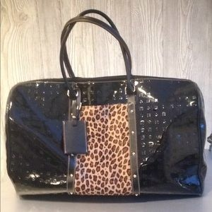 Black patent leather Arcadia weekender bag Arcadia